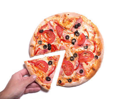 Male hand picking tasty pizza slice, isolated on white background   photo