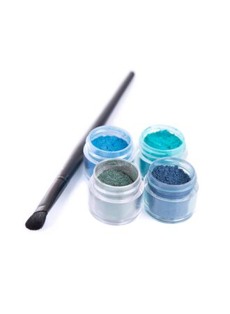 eye shadows: Blue and green eye shadows with make-up brush, isolated on white background