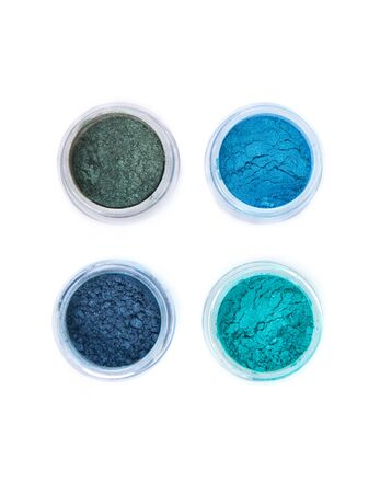 glitter makeup: Top view of mineral eye shadows in pastel colors, top view isolated on white background