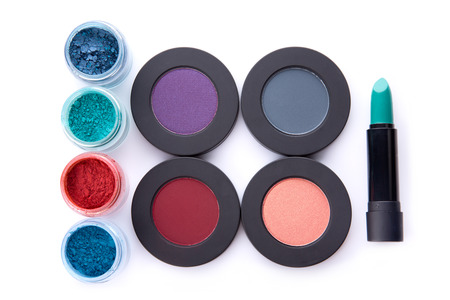 the lipstick: Set of loose and pressed eyeshadows, and lipstick, top view isolated on white background with shadow
