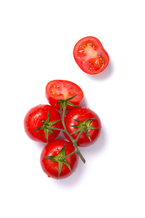 Top view of fresh tomatoes, whole and half cut, isolated on white background