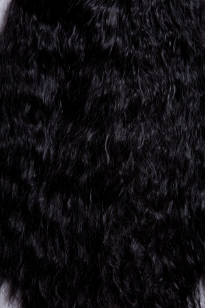 brunets: Texture of black healthy curly hair, soft focus