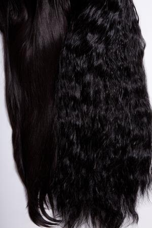 cabello negro: Recta Negro y texturas de pelo rizado, enfoque suave Foto de archivo
