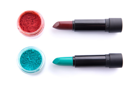 green lipstick: Edgy color lipsticks with matching eye shadows, top view isolated on white background