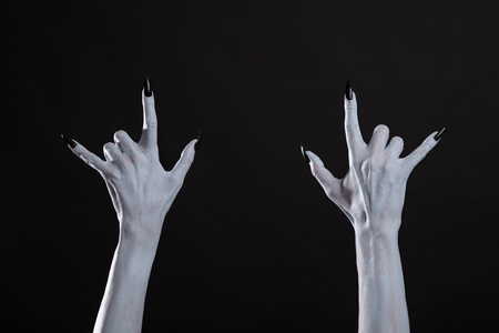 horns: White monster hands showing heavy metal sign, Halloween or music theme