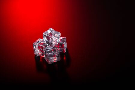solid background: Ice cubes on black background with red club style light
