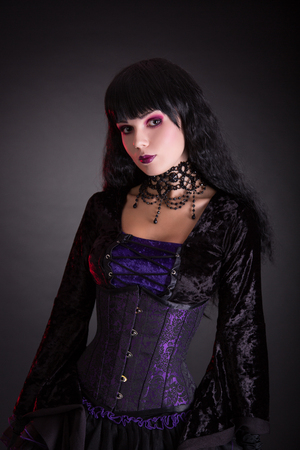 gothic fetish: Attractive gothic girl in Victorian style clothes, studio shot on black background Stock Photo