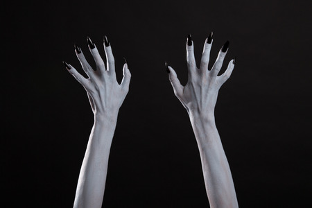 black hands: White witch hands with sharp black nails, Halloween theme