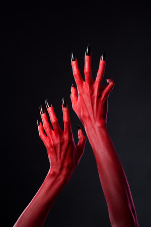 diabolic: Red devil hands with black nails reaching out, Halloween theme