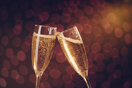 congratulation: Two elegant champagne glasses making toast on holiday bokeh background