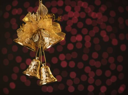 copyspace: Decorative Christmas bells on red holiday bokeh background with copy-space