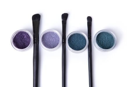 eye shadows: Top view of mineral eye shadows and make-up brushes, isolated on white background