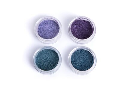 Blue and purple mineral eye shadows, top view isolated on white background Stock Photo