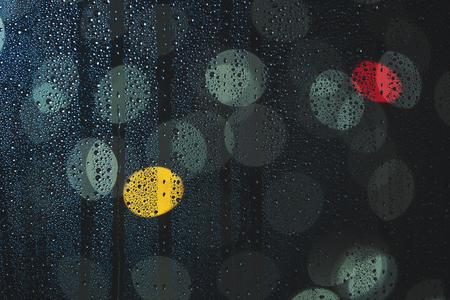 dof: Rain drops on the window, and defocused city lights, focus on drops