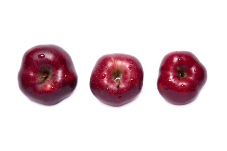 top angle: Top view of three red delicious apples, isolated on white background Stock Photo