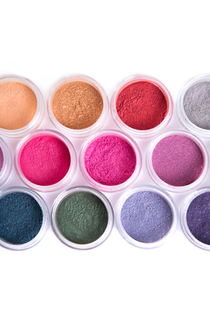 eyeshades: Close-up shot of row of mineral eye shadows, top view isolated on white background