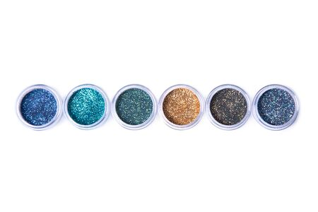 Row of bright glitters in transparent jars, top view isolated on white background Stock Photo