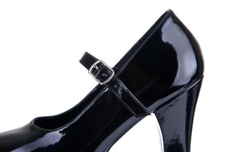 dominatrix: Close-up shot of black shoe with strap belt, isolated on white background Stock Photo