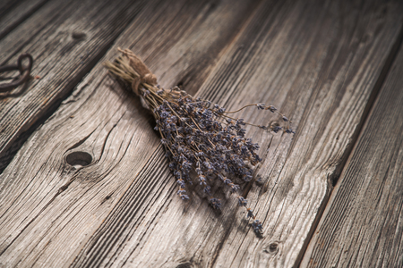 dried herbs: Dried lavender bouquet on grungy wooden background, vintage tone