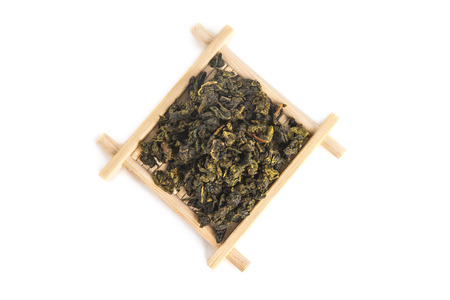 Top view of bamboo serving tray with Tie Guan Yin Oolong tea, isolated on white background
