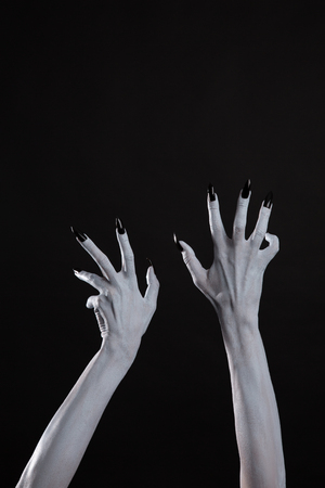 diabolic: Pale ghost hands with sharp black nails, body art, with copy-space for your text Stock Photo