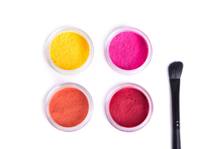 Top view of bright eye shadows and makeup brush, isolated on white background Stock Photo
