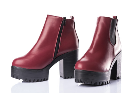 Dark red chunky heel boots, isolated on white background Фото со стока