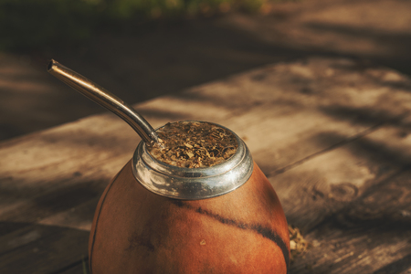 Close-up shot of Argentinean yerba mate drink in traditional calabash, selective focus Фото со стока
