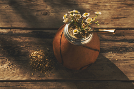 High angle view of  Argentinean yerba mate drink with chamomile flowers Фото со стока