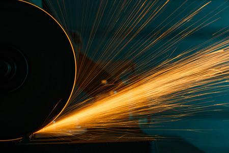 Angle grinder sparks, indoors shoot over metal background