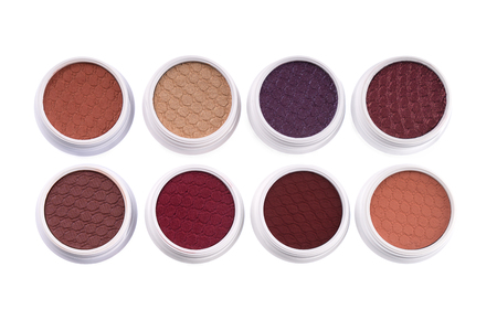 Set of colorful eye shadows, top view isolated on white background  Фото со стока