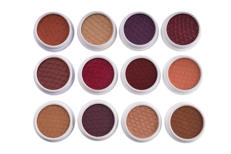 Top view of colorful eye shadows, isolated on white background  Фото со стока