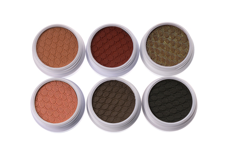 Top view of a set of colorful eye shadows, isolated on white background