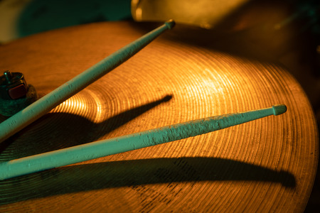 Drum sticks and cymbals, studio shot with selective focus