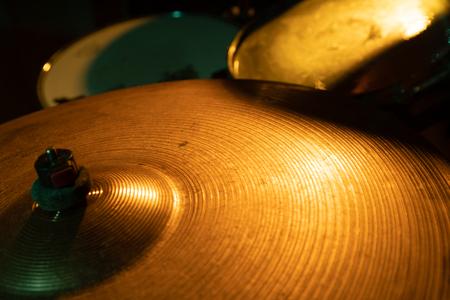 Closeup shot of rock band drum set with cymbals, selective focus