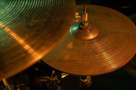 Studio shot of rock band drum set, focus on cymbals