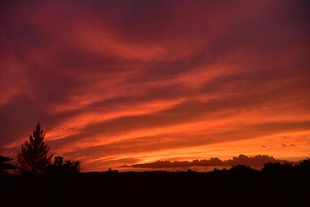 Sunset on the Caribbean Sea. Buildings in the distance Standard-Bild - 120158249