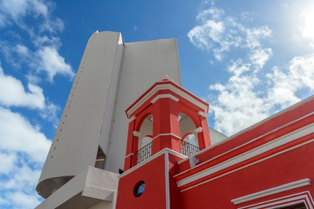 Red and white mexican building against sky Stock fotó