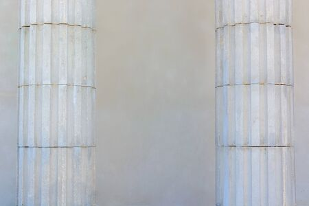 Two white columns on a wall background Stock Photo