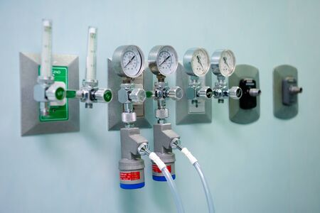 Pressure gauges on the wall in the operating room to adjust oxygen pressure. Mexico.