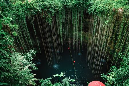 Cenote Ecoturistico Ik-Kil with blue clear water. Inside view.