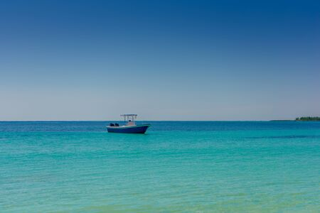 The boat in the Caribbean Sea on a sunny day. Clear water.