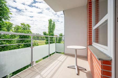 Classic balcony, real estate photo, wide angle.