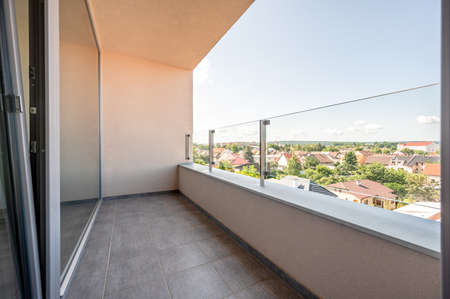 View from balcony, sunny day, clouds, wide angle real estate photo. Standard-Bild