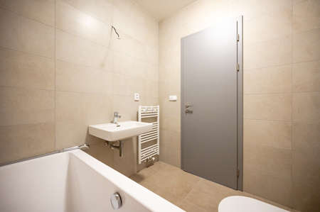 Bathroom and toilet in an apartment for rent. Real estate photo.