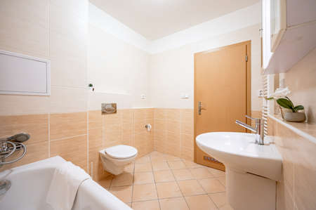 A bathroom restroom in an apartment.