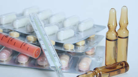 Pharmacy theme, tablets, pills capsule heap mix therapy drugs with medicine antibiotic and thermometer. Medicine background for medical concept. Close up of capsules