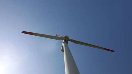 Wind turbines for electric power production on beautiful sunny summer with blue sky. Green ecological power energy generator. Alternative energy source. renewable wind energy Archivio Fotografico
