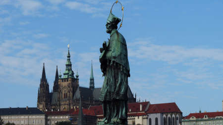 Prague, Czech Republic. Charles Bridge (Karluv Most) with its statuette and Old Town Tower. Lesser Town Bridge Tower and the tower of the Judith Bridge