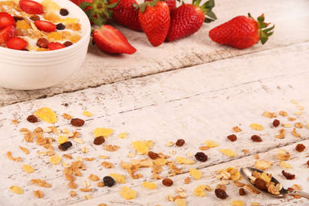 Bowl of yogurt with strawberries and granola muesli, over a white rustic wood background. Stok Fotoğraf